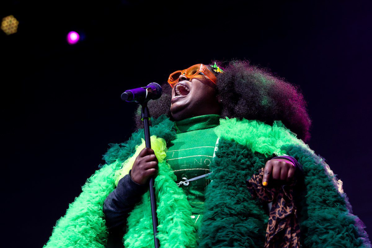 Frontwoman Tank from New Orlean's funk/jazz/soul band Tank and the Bangas, sings on stage.